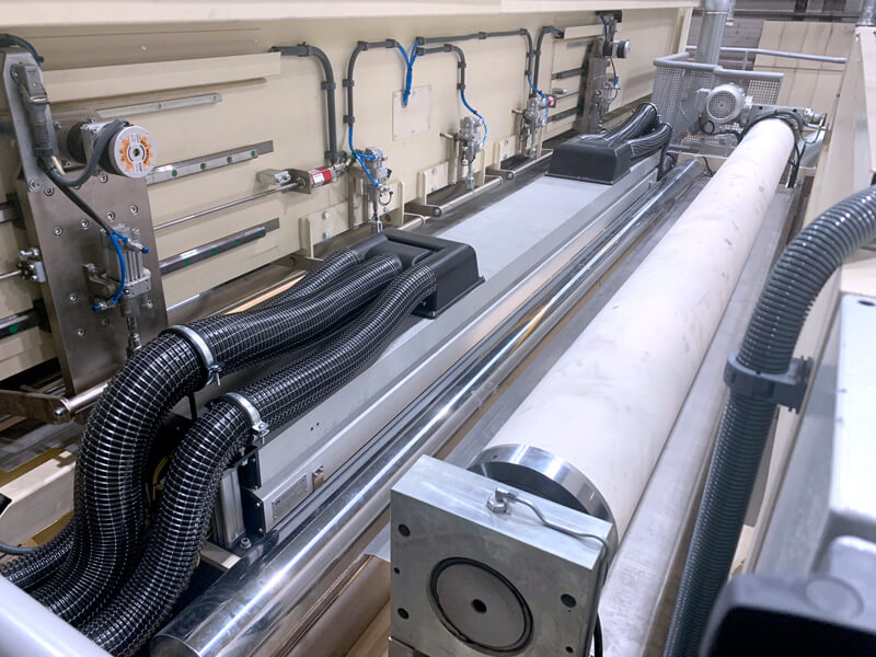 varel-weducon-web-cleaner-mounted-between-slitters-and-pull-roll-section